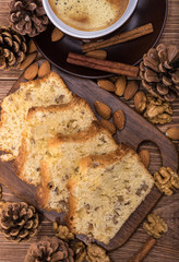 Homemade nut cake with cup of coffe on wooden background.
