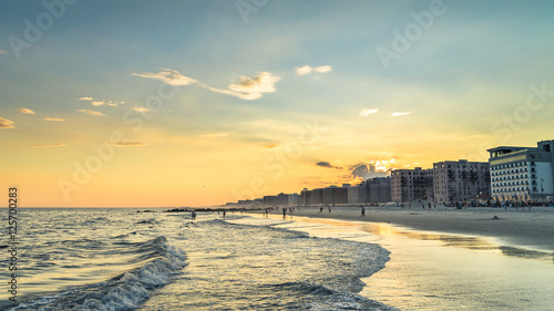 Fényképezés  Long beach at the evening. Summer weather, splittoned image
