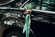 Little Bouquet Of Roses And Green Ribbons Hangs On The Door's Ha