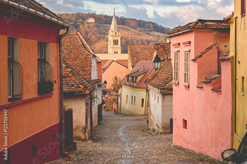 Stone paved old streets with colorful houses in Sighisoara fortr Tapéta, Fotótapéta