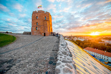 View On Gediminas Tower On The Castle Hill During The Sunset In The Old Town Of Vilnius City In Lithuania. This Tower Is Very Popular Tourist Destination In Vilnius