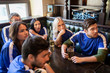 fans or friends watching football at sport bar