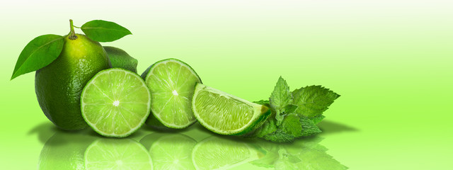 FototapetaSliced and whole limes in a panoramic