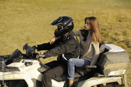 Man and girl ride quad