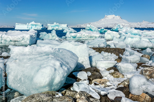 Deurstickers Poolcirkel Huge blue icebergs driftingand laying ashore with Sermitsiaq mou