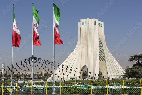 Azadi Tower with flasgs of Iran, Tehran, Iran