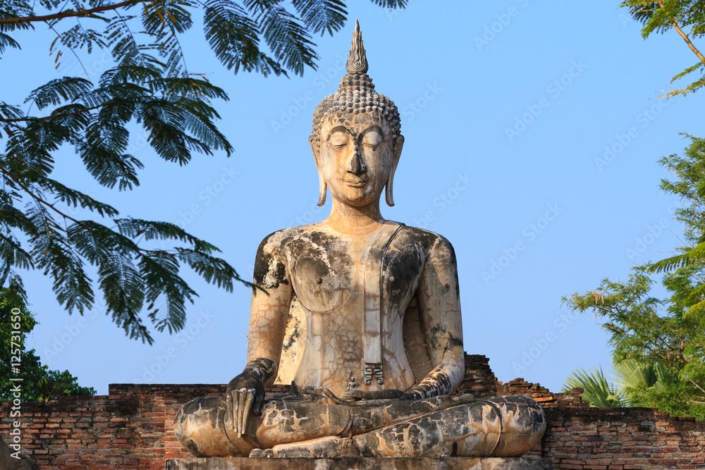 Fotografie, Obraz  Ancient buddha. Sukhothai Historical Park or Old Sukhothai City.