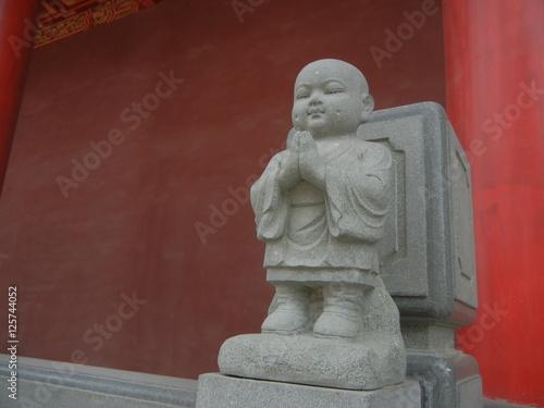 Fotografie, Obraz  Apprentice Buddhist Monk Statue at White Pagoda Temple in Manchuria City Shenyan