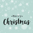 black and blue vintage christmas card with white snowflakes