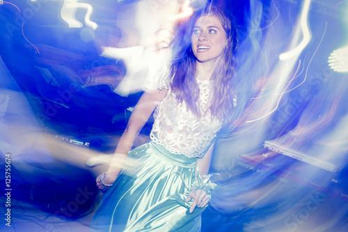 Wall Murals Mermaid Brunette woman dances in blue light