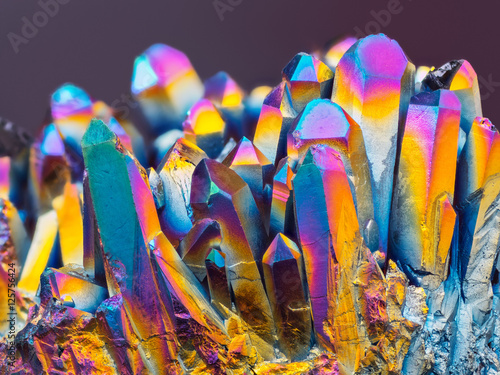 Poster Macro photography Extreme sharp Titanium rainbow aura quartz crystal cluster stone taken with macro lens stacked from more shots into one very sharp image with blurry background.