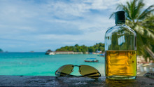 Beach Party. Holiday Fun Concept. Bottle Of Rum And Sunglasses W