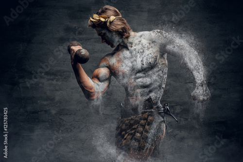 Fototapeta Ancient Greek male sportsmen holds dumbbell.