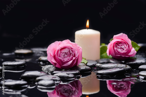Poster Spa Still life with two pink rose with candle and therapy stones