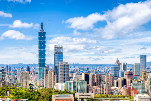 фотография  Cityscape of Taipei with skyscraper under dramatic clouds at blue sky in Taiwan