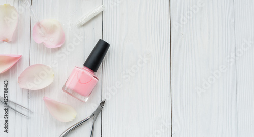 Fotografie, Obraz  bottle of nail polish on wooden background top view