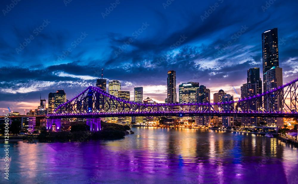 Fototapeta Vibrant night time panorama of Brisbane city with purple lights