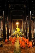 Buddhist Monks Pray And Medita...