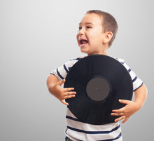Portrait Of A Little Boy Holding A Vinyl Record