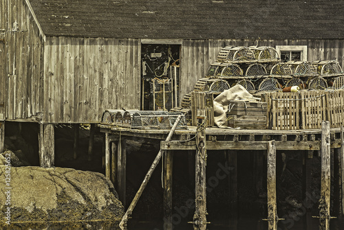 Wooden fishing pier with lobster traps set up and ready for a day of fishing Poster