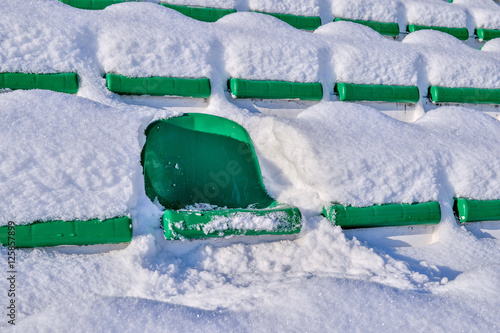Foto op Plexiglas Stadion Background chairs at stadium , winter