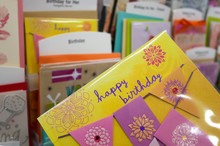 Close Up Woman Holding Happy Birthday Card Inside Superstore