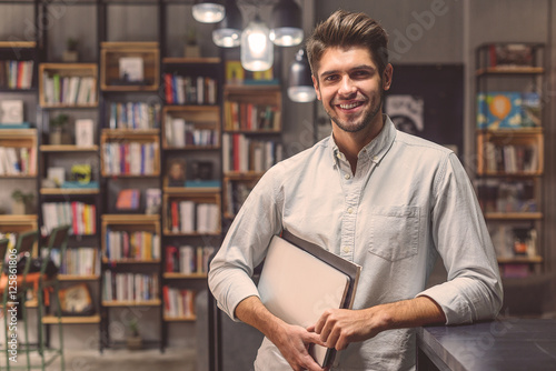 Valokuva  Handsome man studing in campus library