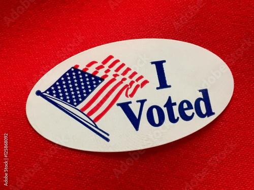"Valokuva ""I voted"" sticker on red fabric"