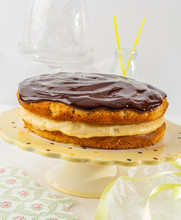 A Boston Cream Pie Is A Cake That Is Filled With A Custard Or Cream Filling And Covered With Chocolate