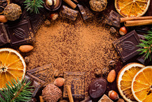Christmas Background With Sweets: Assortment Of Chocolates, Truffles, Candies, Chocolate Barks, Spices And Nuts With Empty Space For Text. Horizontal