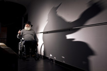 A Man With A Big, Grey Beard Is Sitting In The Wheelchair