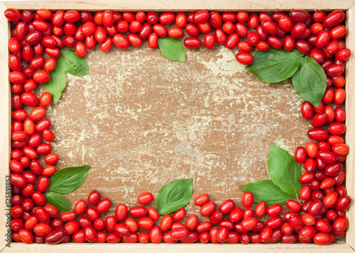 Cornelian cherries in wooden frame Fototapet