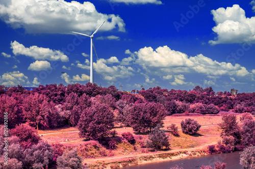 Foto op Plexiglas Crimson Wind turbine on the hill produces green clean energy infrared