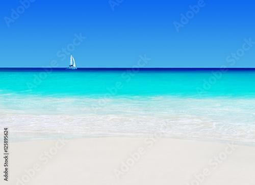 Fotografie, Obraz  Yacht under sail at Anse Georgette beach, Praslin island, Seychelles