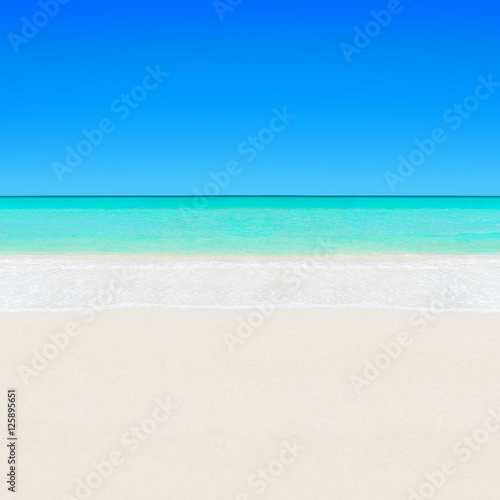 Tropical white sandy beach and turquoise clear ocean water backg