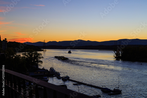Fotografie, Tablou  Hudson River at dusk in Hudson with lighthouse and boats