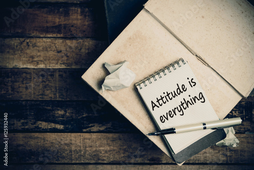 Attitude is everything on pages sketch book on wood table vertic Tablou Canvas