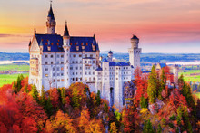 Germany. Famous Neuschwanstein Castle In The Background Of Trees With Yellow And Green Leaves And Valley.