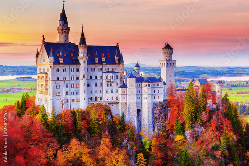 Aluminium Prints Castle Germany. Famous Neuschwanstein Castle in the background of trees with yellow and green leaves and valley.