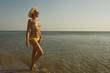 Beautiful woman in bikini relaxing on the beach