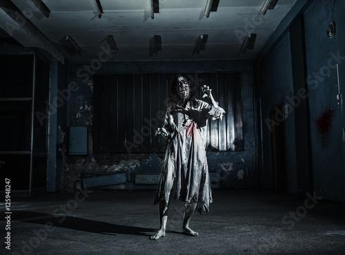 Portrait of the horror zombie woman. Halloween. Wallpaper Mural