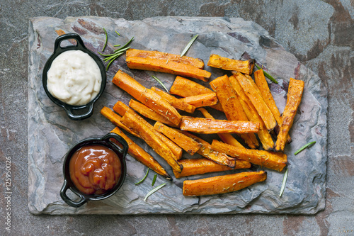 Canvas Print Sweet Potato Fries Top View on Slate with Ketchup and Mayonnaise