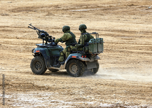 Soldiers on a quad bike in exploration