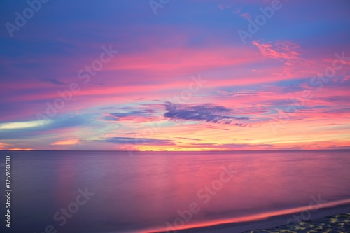 Foto op Canvas Candy roze Sunrise morning time before. Colorful sky and sea water reflect