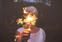 Woman Hand Holding Sparkler Ou...