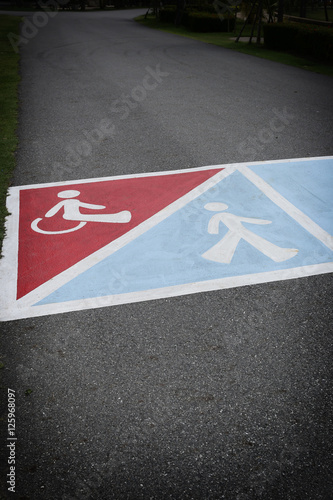 Photo sur Aluminium F1 asphalt road in the park and have symbol of people with disabili