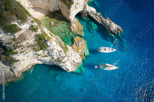 Sailboats in a beautiful bay, Paxos island, Greece