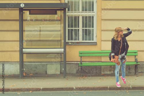 Fotografie, Obraz  Girl waiting for a bus.
