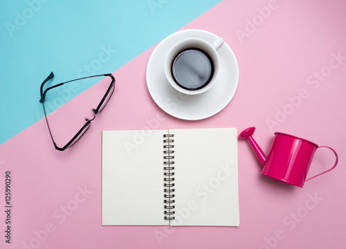 Fototapeta Top view of colorful cup of coffee and glasses on color blue and pink  background for create idea for business or design .Relax coffee time .