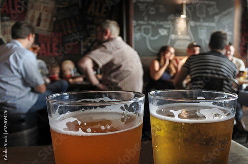 Photo  Two glasses of beer on a pub table